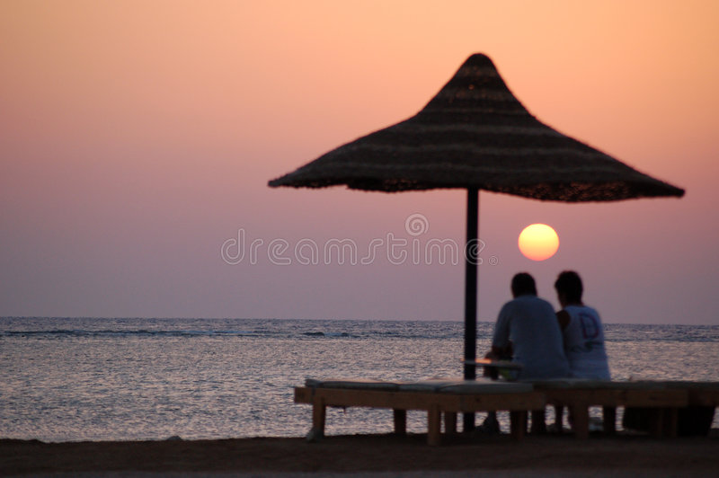 Couple Looking At Sunset Sea Royalty Free Stock Image