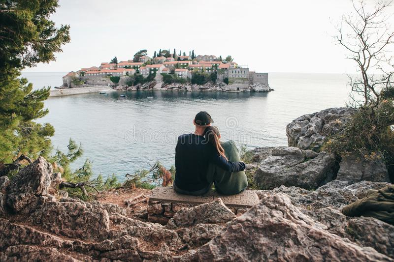 Couple looking at Sveti Stefan royalty free stock image