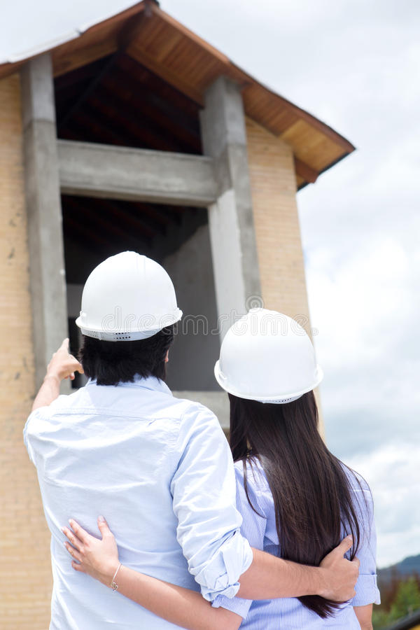 Download Couple Looking At Their New House Stock Photo - Image: 26932482