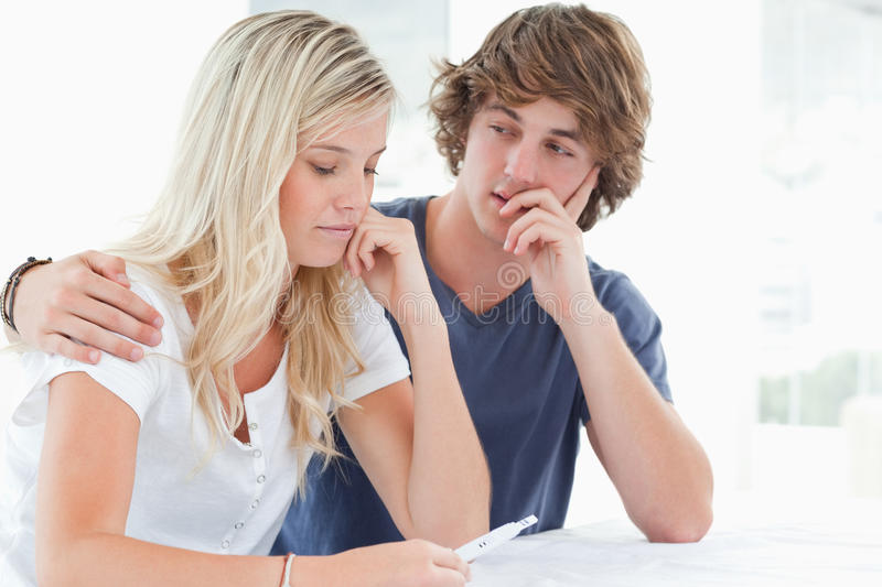 Download Couple Looking Worried As The Girl Holds A Pregnancy Test Stock Photo - Image: 25336326