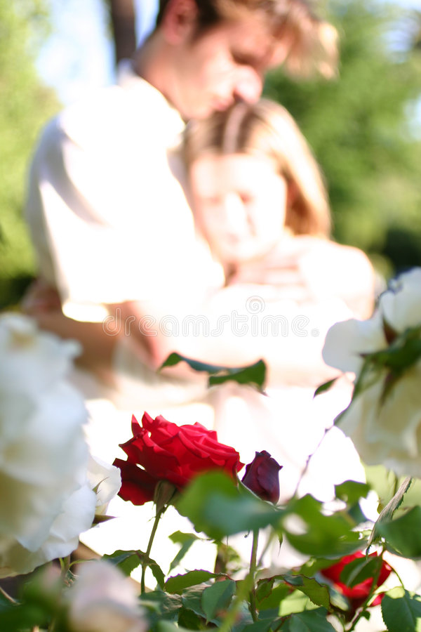 Couple in love. Holding each other. Faces really blury and overexposed stock photography
