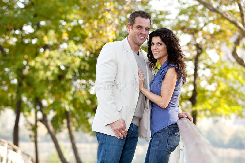 Couple Love. A couple looking at the camera and smiling royalty free stock photo