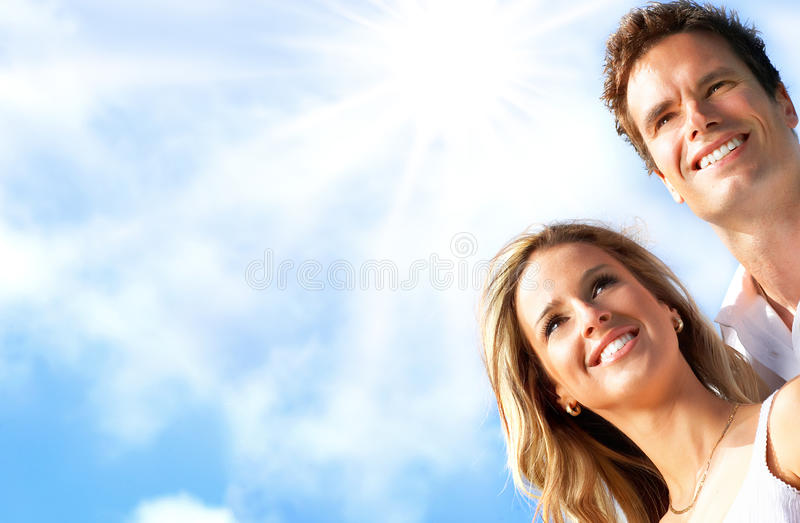 Couple in love. Young love couple smiling under blue sky royalty free stock photos