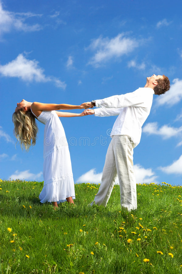Couple in love. Young love couple smiling under blue sky royalty free stock photo