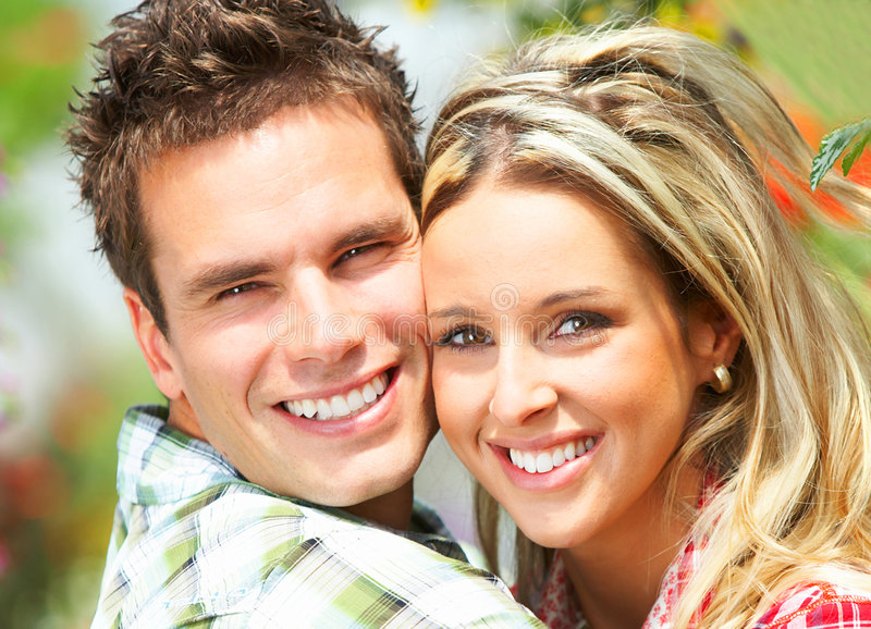 Couple in love. Young happy smiling couple in love stock photography