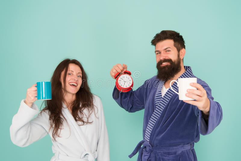 Couple in love alarm clock. love relations. Caffeine power concept. tea time at home. hard morning. morning couple drink royalty free stock photo