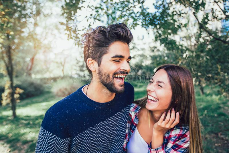 Couple in love in autumn. Smiling young couple hugging in the park stock photo