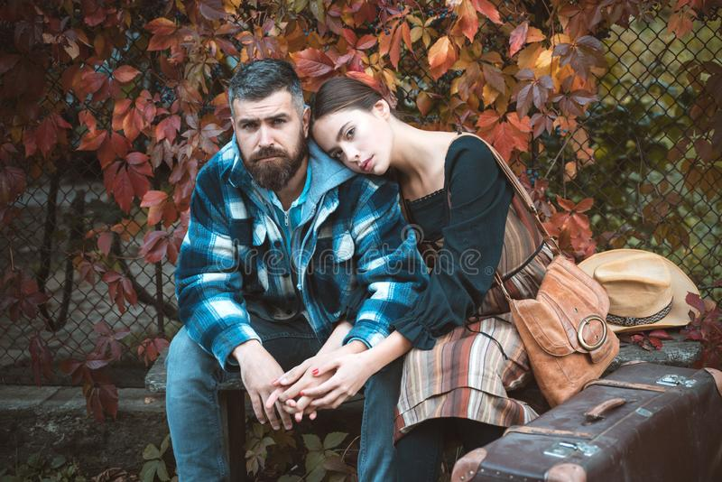 Couple in love in autumn leaves. Laughing bearded man and pretty woman outside. Bearded man and brunette woman with stock photo