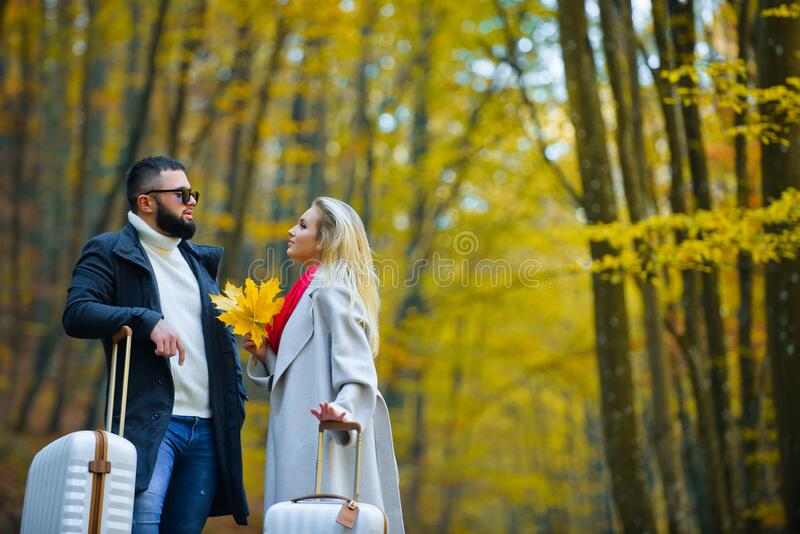 Couple in love in autumn leaves. Travel people. Autumnal Dreams. Couple in love in autumn leaves. Travel people. Autumnal Dreams royalty free stock image