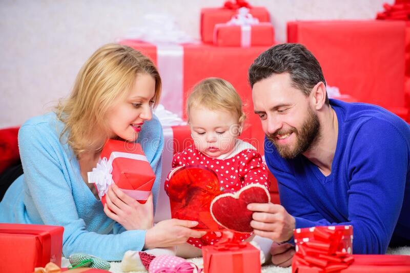Couple in love and baby daughter. Valentines day concept. Together on valentines day. Lovely family celebrating stock photo