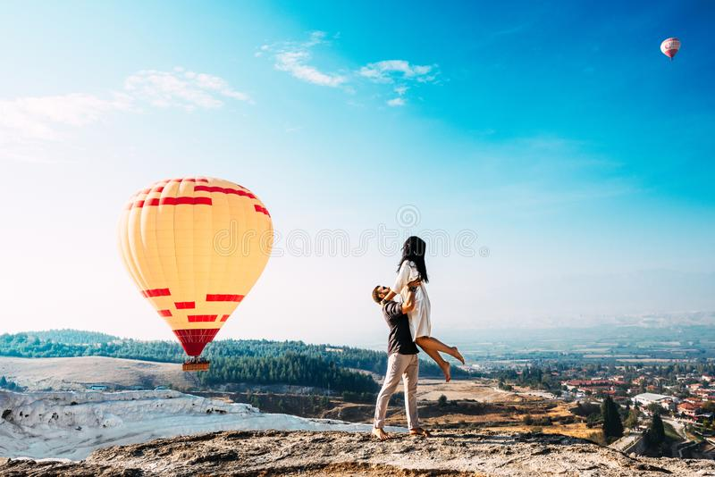 Couple in love among balloons. A guy proposes to a girl. Couple in love in Pamukkale. Couple in Turkey. Honeymoon in the mountains royalty free stock photos