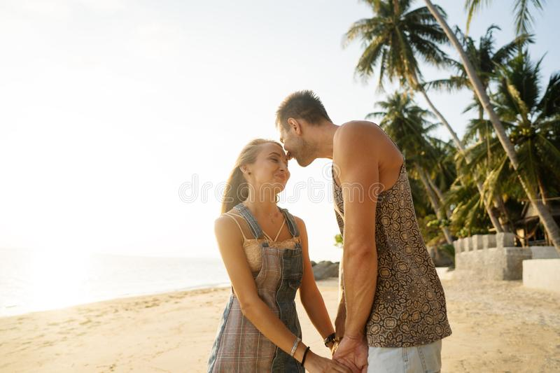 Couple in love on the beach at sunset royalty free stock photos