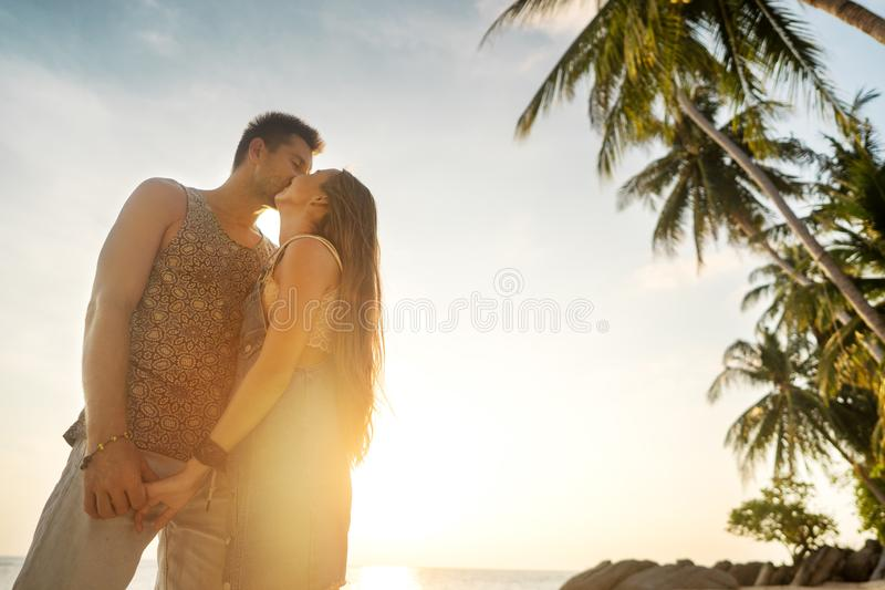Couple in love on the beach at sunset stock photography