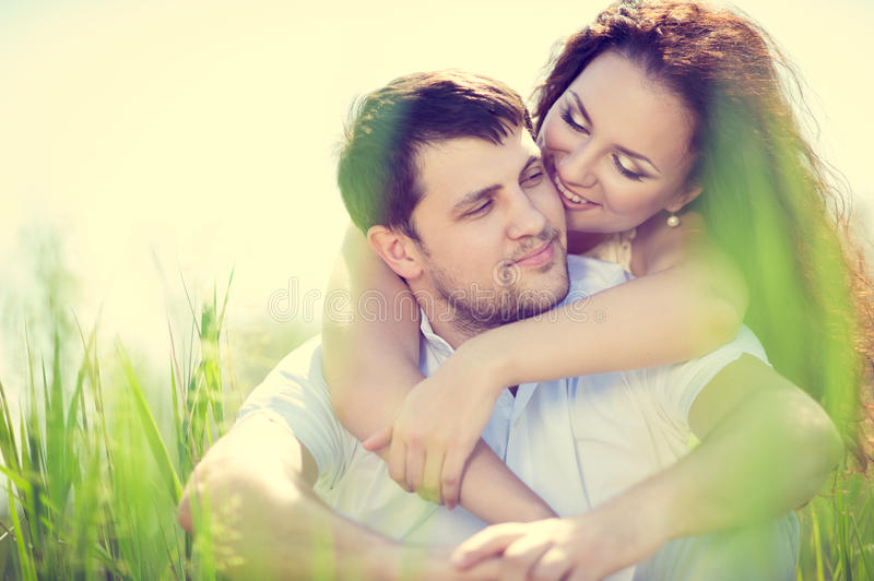 Couple in love. Beautiful couple in love tenderly embraces outdoor royalty free stock images