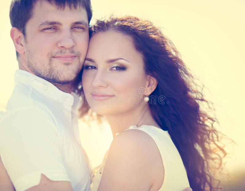 Couple in love. Beautiful couple in love tenderly embraces outdoor royalty free stock image