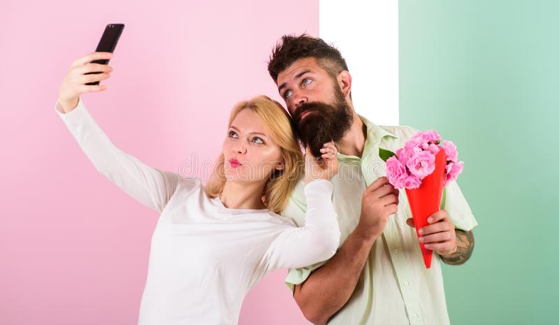 Couple in love bouquet dating celebrate anniversary relations. Sharing happy selfie. Capturing moment to memorize. Woman royalty free stock photos