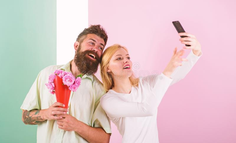 Couple in love bouquet dating celebrate anniversary relations. Sharing happy selfie. Taking selfie photo. Capturing. Moment to memorize. Woman capturing happy royalty free stock image