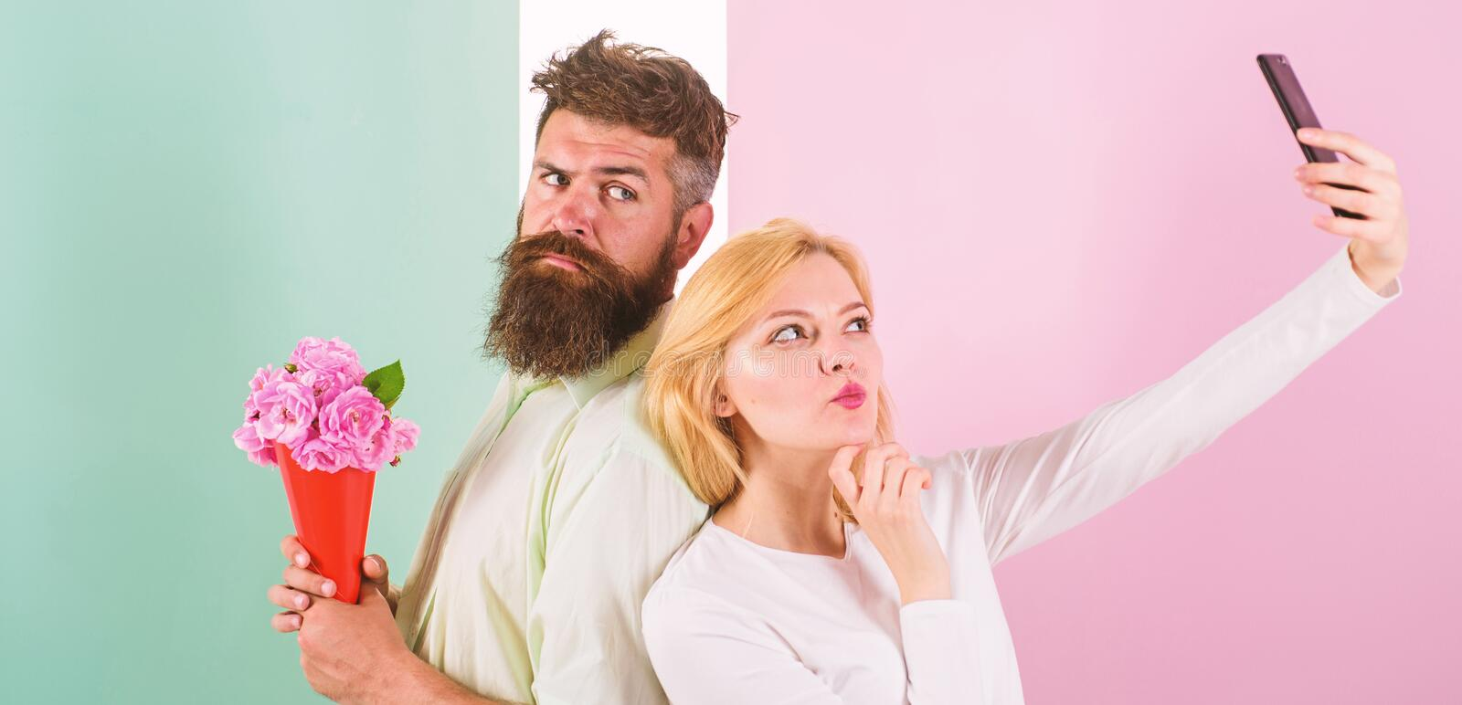 Couple in love bouquet dating celebrate anniversary relations. Sharing happy selfie. Woman capturing happy moment. Boyfriend bring bouquet flowers. Capturing stock photography