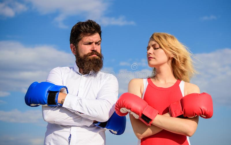 Couple in love boxing gloves sky background. Man and girl after fight. Family life reconciliation and compromise. Marriage everyday struggle. Marriage as test royalty free stock photos