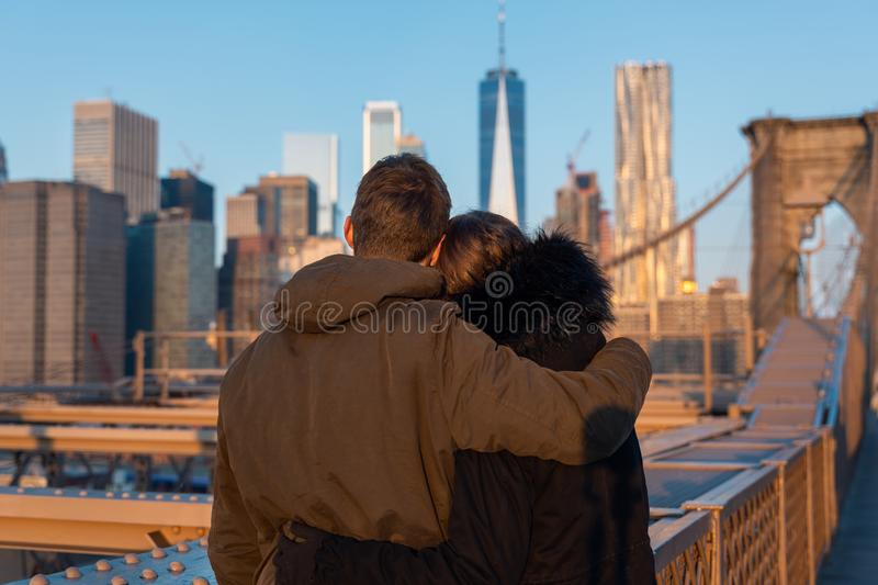 Couple in love on the brooklyn bridge in new york stock photo