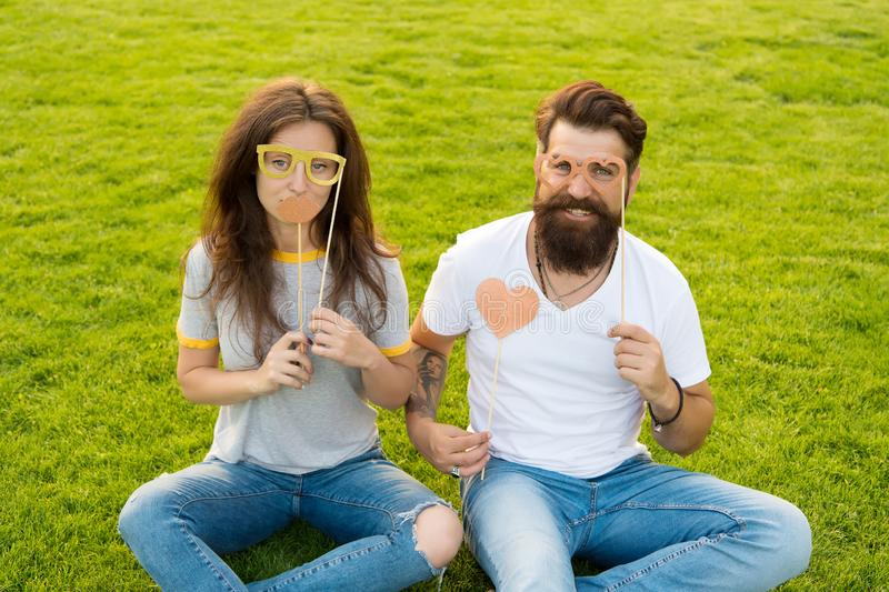 Couple in love cheerful youth booth props. Emotional people. Couple dating. Carefree couple having fun green lawn. Man royalty free stock images