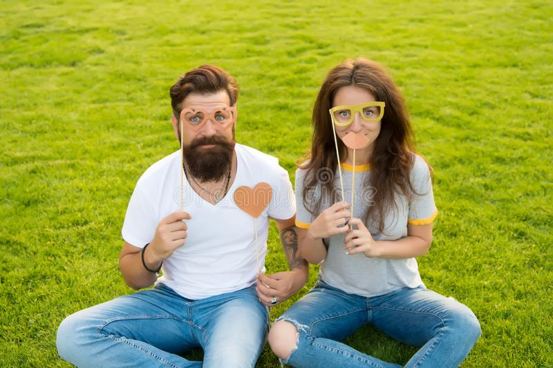 Couple in love cheerful youth booth props. Emotional people. Man bearded hipster and pretty woman cheerful faces. Youth royalty free stock image