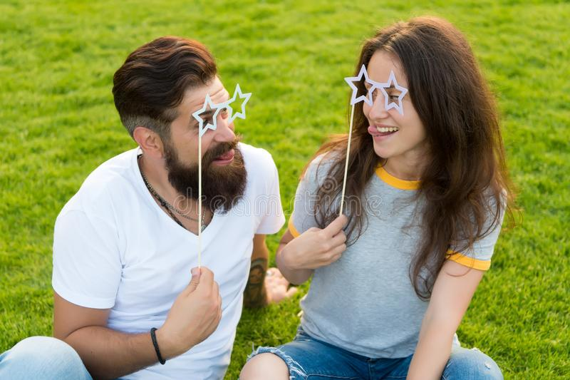 Couple in love cheerful youth booth props. Man bearded hipster and pretty woman cheerful faces. Youth day. Summer stock photography