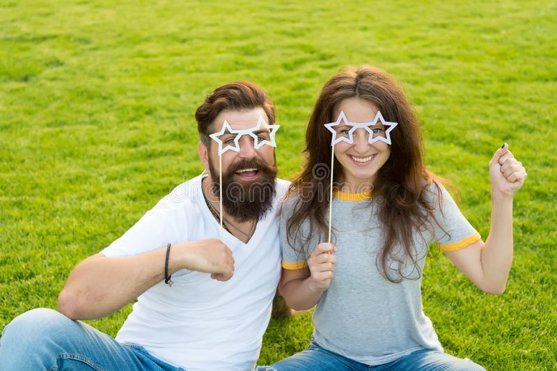 Couple in love cheerful youth booth props. Youth day. Summer entertainment. Emotional people. Couple dating. Carefree royalty free stock images