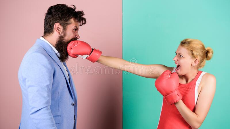 Couple in love competing in boxing. Conflict concept. Gender battle. Gender equal rights. Family quarrel. Strong punch royalty free stock images