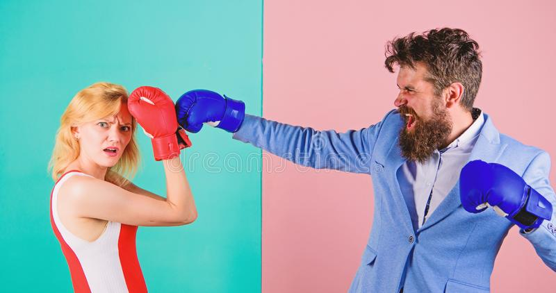 Couple in love competing in boxing. Female and male boxers fighting in gloves. Domination concept. Gender battle. Gender royalty free stock images
