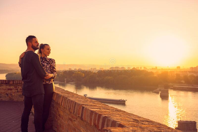 Couple in love.couple enjoying together on romantic sunset royalty free stock photo