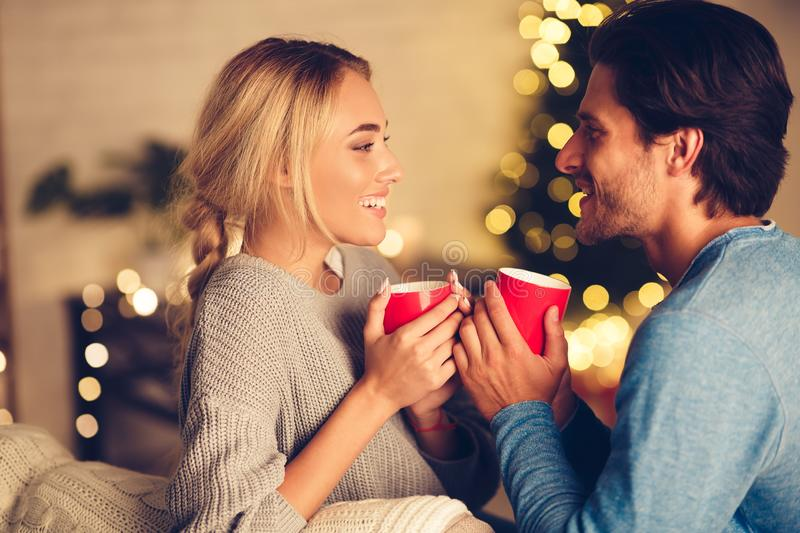 Couple in love drinking tea and enjoying winter holidays stock image