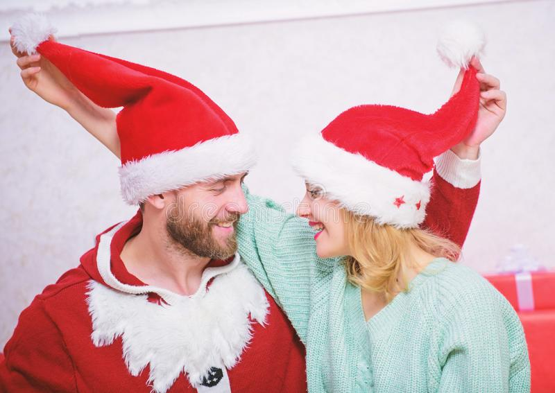 Couple in love enjoy christmas celebration. Couple wear hats as santa claus christmas tree background. It is easy to royalty free stock photo