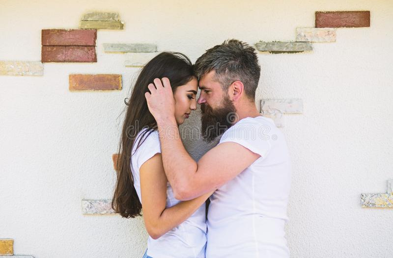 Couple in love enjoy each other romantic date. Man bearded and girl hugs or cuddling. Tender hug. Couple in love royalty free stock image