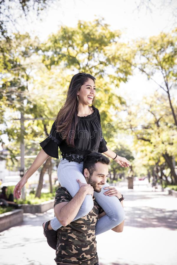 Couple in love. Enjoying happy in public park royalty free stock photos