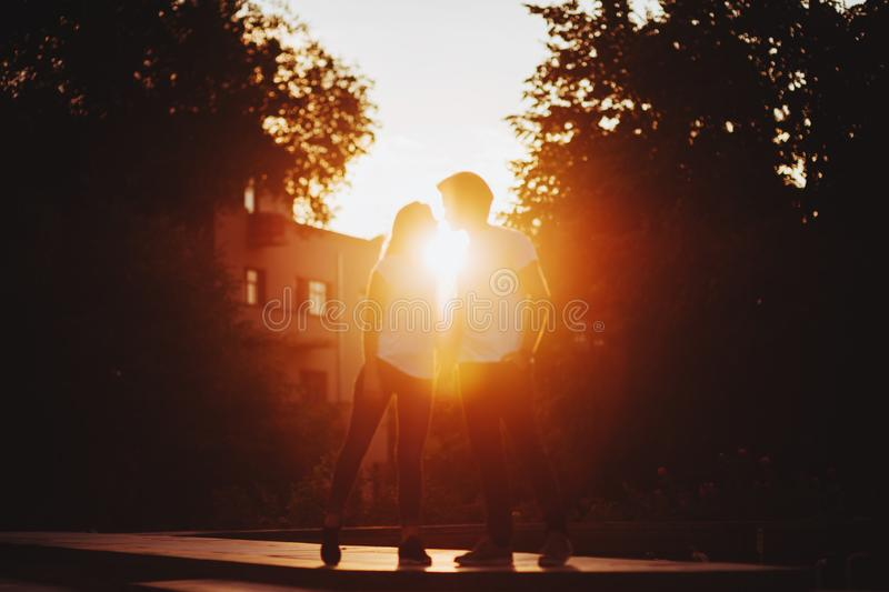 Couple in love enjoying moments during sunset stock photo