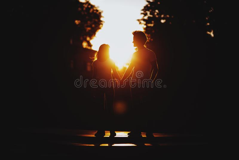 Couple in love enjoying moments during sunset royalty free stock photo