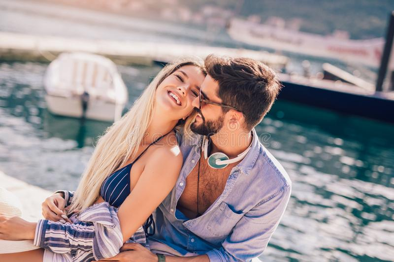 Couple in love, enjoying the summer time. By the sea stock photography