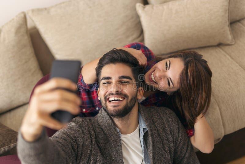 Couple taking a selfie royalty free stock photos