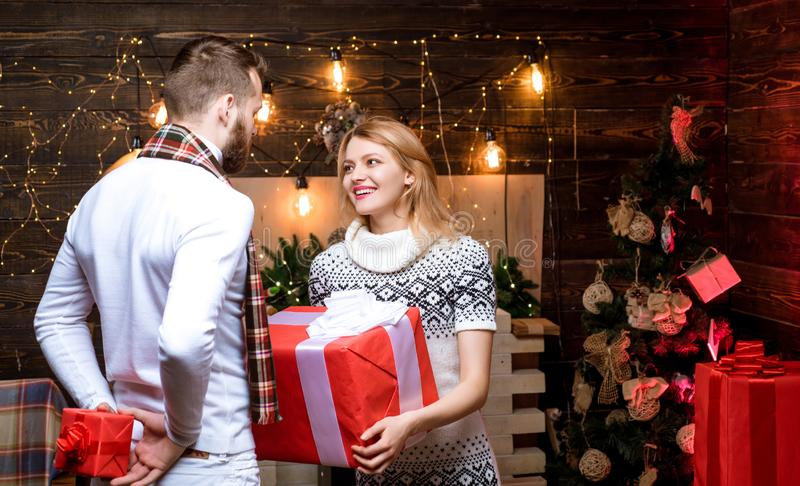 Couple in love exchanging christmas gifts. Happy family couple. Christmas interior. Xmas tree. New Year. Merry christmas royalty free stock image
