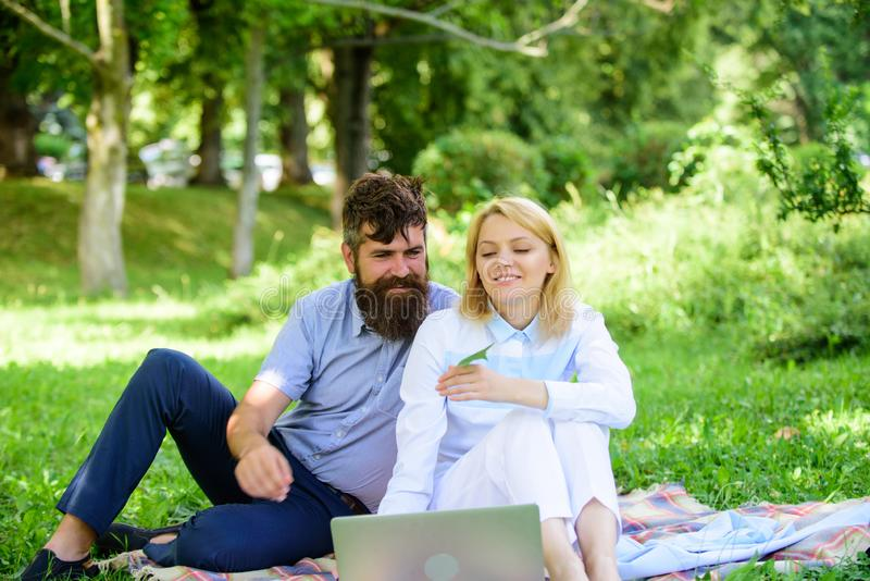 Couple in love or family work freelance. Freelance life benefit concept. Modern online business. Couple youth spend. Leisure outdoors working with laptop. How royalty free stock photos