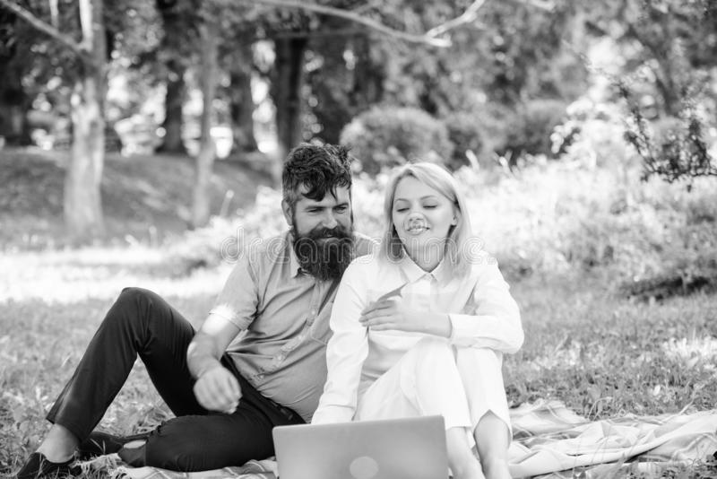 Couple in love or family work freelance. Freelance life benefit concept. Modern online business. Couple youth spend. Leisure outdoors working with laptop. How royalty free stock photo