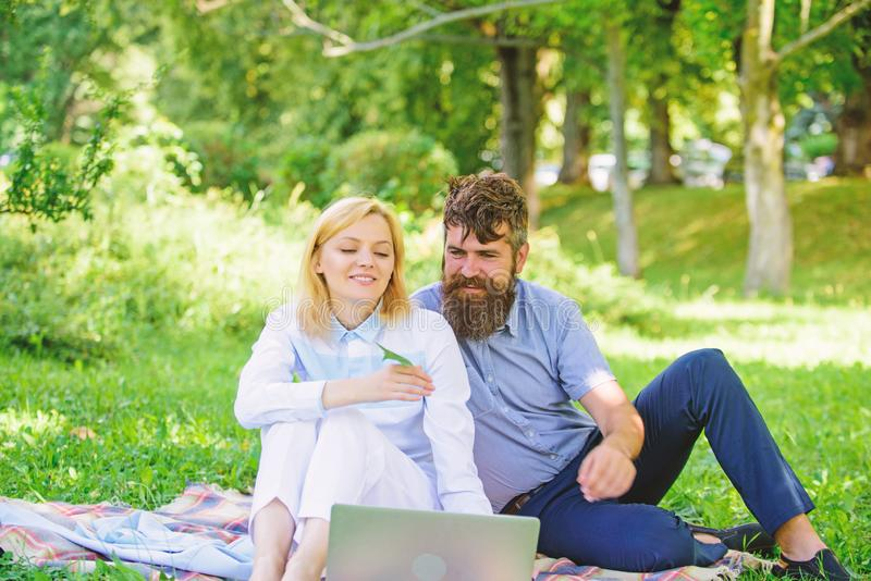 Couple in love or family work freelance. Freelance life benefit concept. Modern online business. Couple youth spend. Leisure outdoors working with laptop. How royalty free stock image