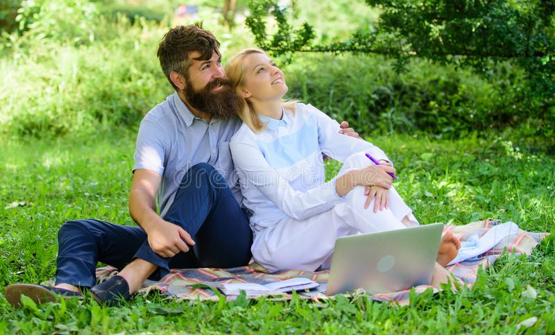 Couple in love or family work freelance. Modern online business. Freelance life benefit concept. Couple youth spend. Leisure outdoors working with laptop. How royalty free stock photos