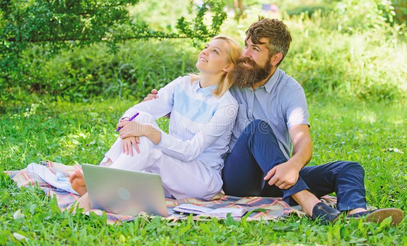 Couple in love or family work freelance. Modern online business. Freelance life benefit concept. Couple youth spend. Leisure outdoors working with laptop. How stock image