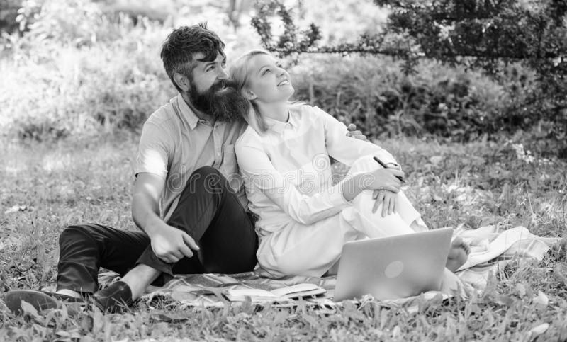 Couple in love or family work freelance. Modern online business. Freelance life benefit concept. Couple youth spend. Leisure outdoors working with laptop. How royalty free stock photography