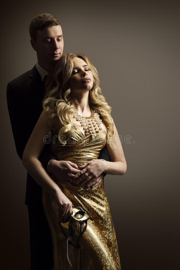 Couple in Love, Fashion Model Man and Woman Beauty Portrait. Dreaming Girl Well Dressed in Golden Dress royalty free stock photo