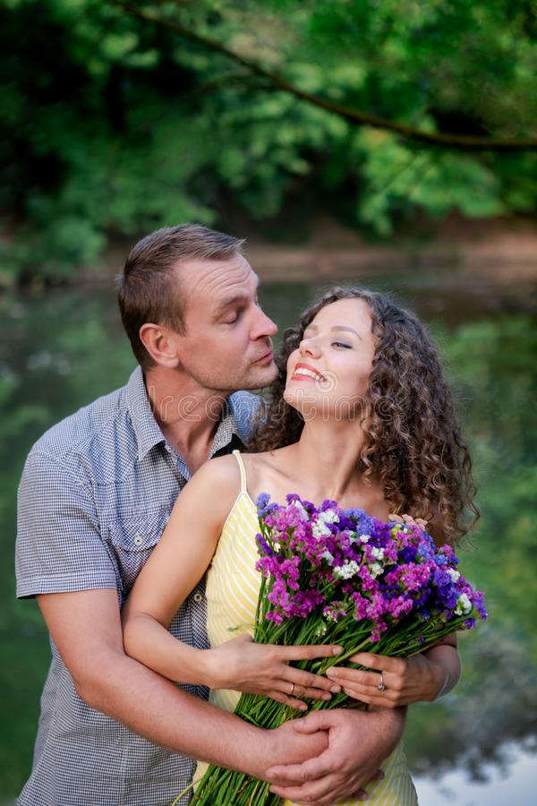 Couple in love flirting, happy woman with flowers royalty free stock photography