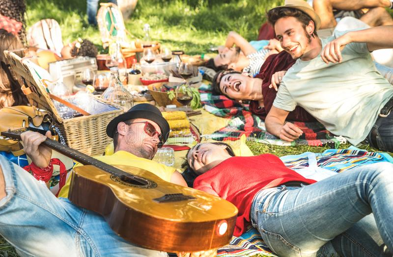 Couple in love with friends group having fun cheering at bbq picnic stock photos