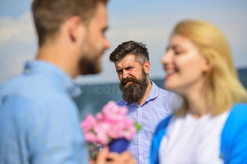 Couple in love happy dating, jealous bearded man watching wife cheating him with lover. Lovers meeting outdoor flirt stock photos
